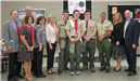 Eagle Scouts, their parents, and Legislator Anker.