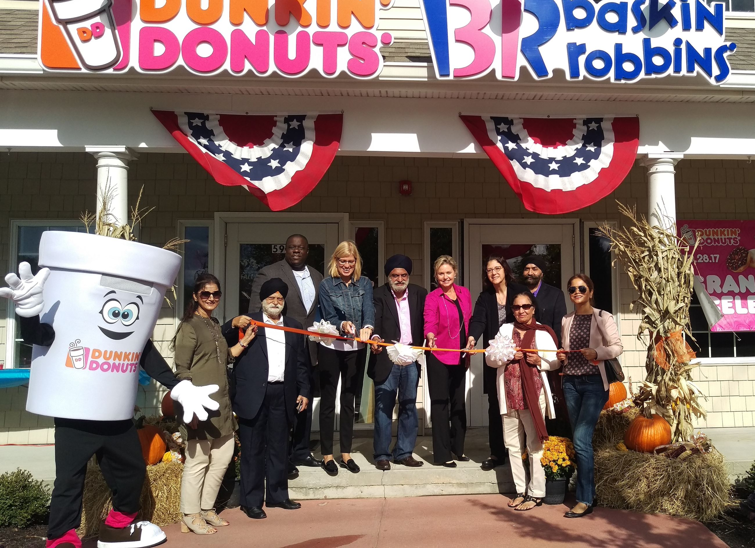 Residents gather from the ribbon cutting of the new Dunkin Donuts