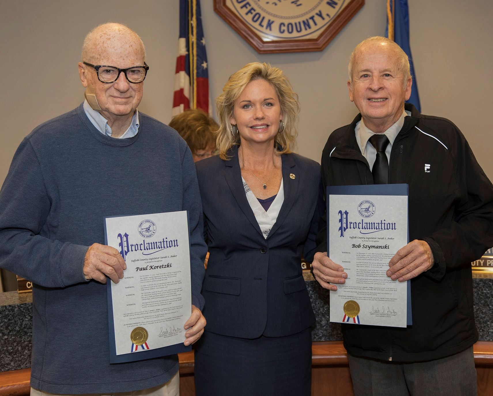 County Legislator Sarah Anker honored Coaches Paul Koretzki and Bob Syzmanski with proclamations.