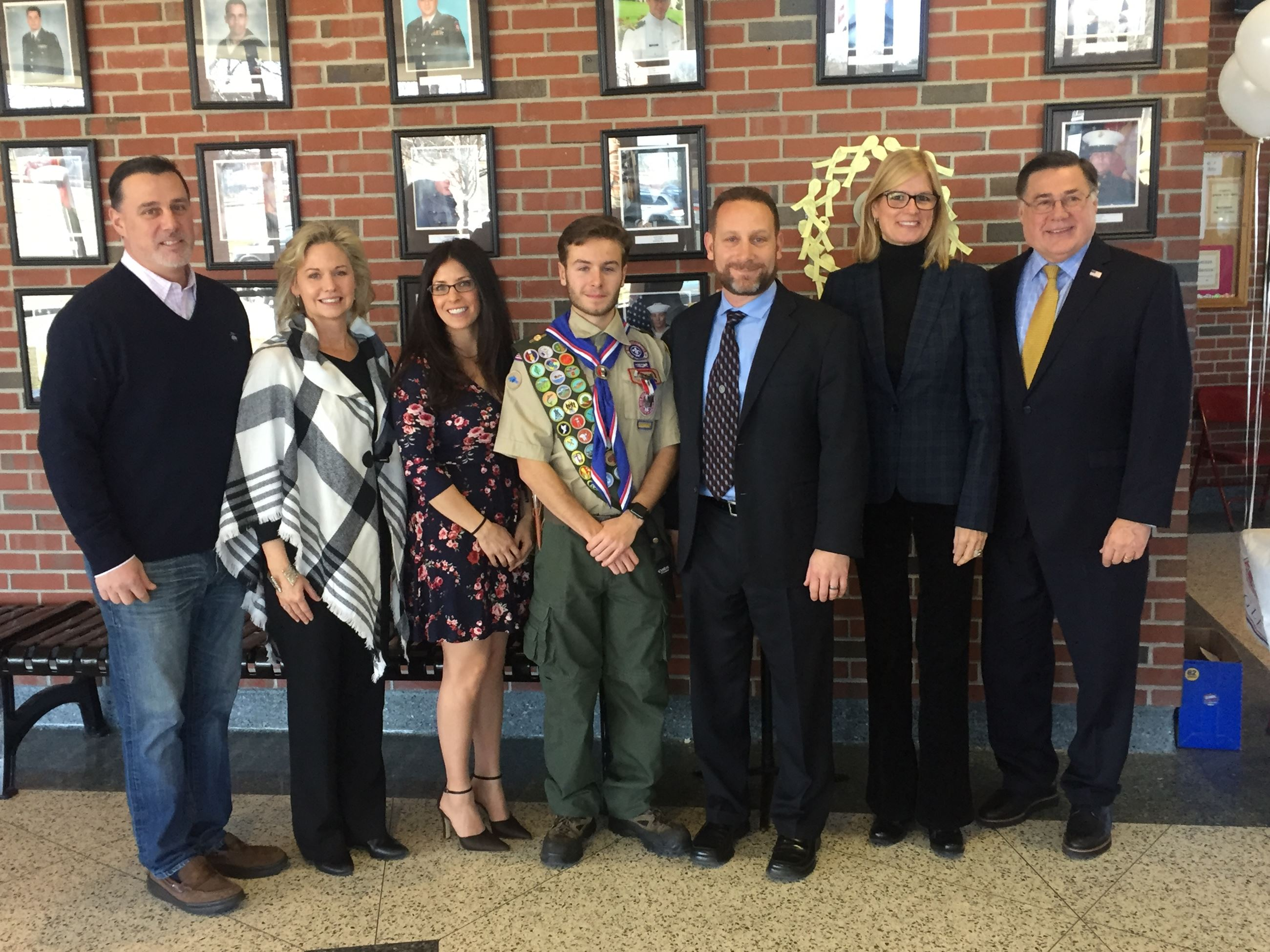 Legislator Anker and elected officials with Eagle Scout James Snider and his parents, James and Kim