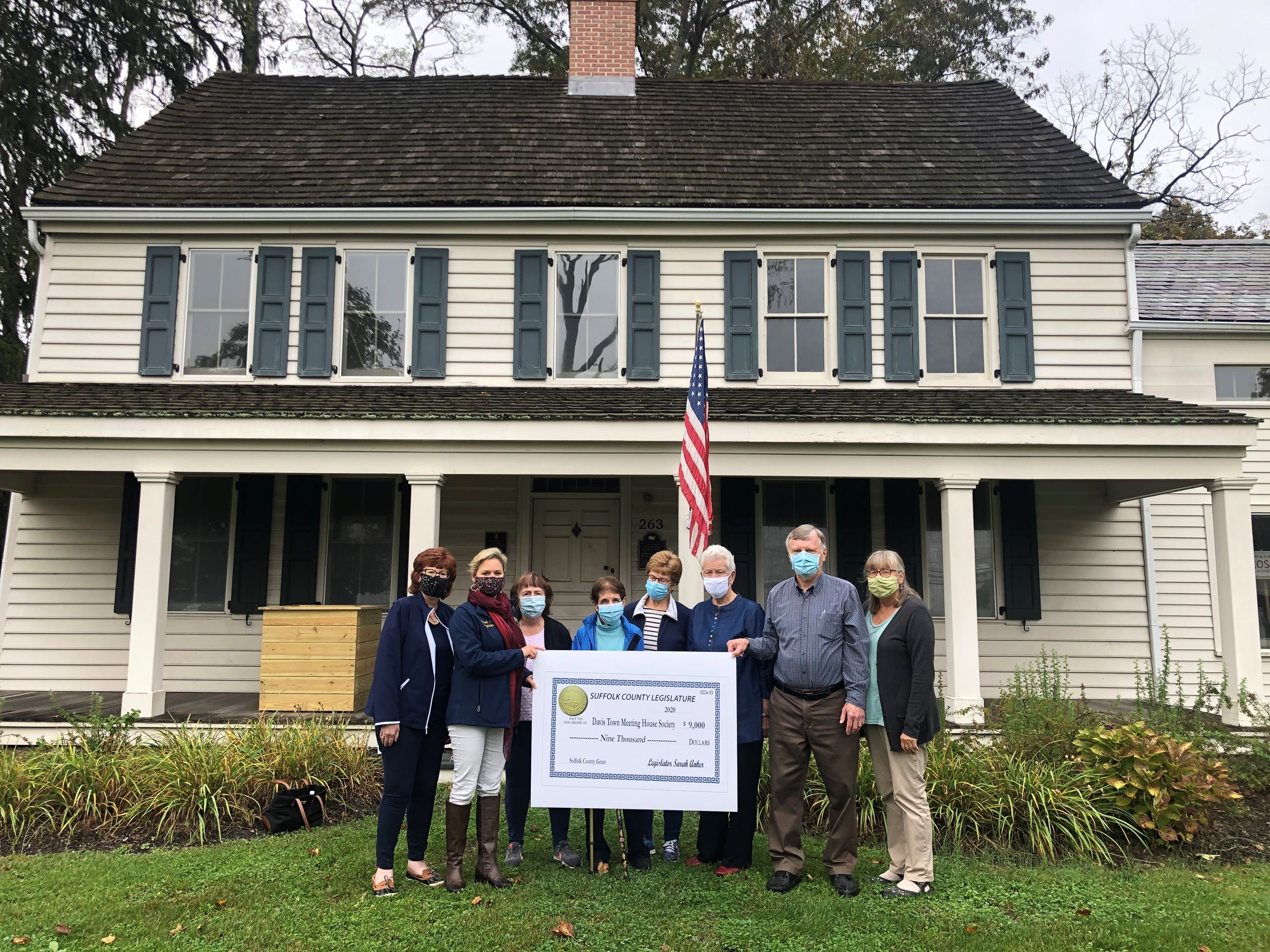Legislator Anker and Davis Town Meeting House Society Members holding grant check